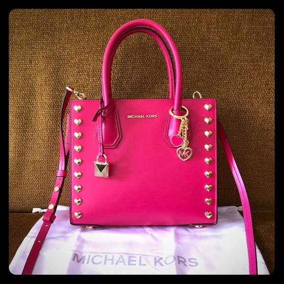 69ba8c6ccaad Michael Kors Mercer Medium Ultra Pink Stud Hearts.  M 5b7dd5f7fb38032c6c3a8375